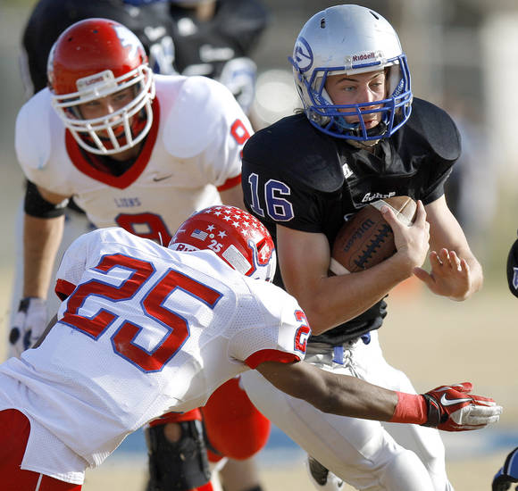 Guthrie's Bryan Dutton tries to get past Durant's Gabriel Louis during the first round of the Class 5A high school football playoffs in Guthrie, Okla., Saturday, Nov. 12, 2011. Photo by Bryan Terry, The Oklahoman