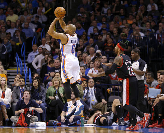 Derek Fisher shoots a three-point basket in front of Portland's Mo Williams on Jan. 21. Photo by Bryan Terry, The Oklahoman