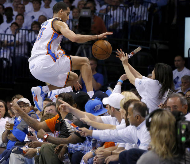Oklahoma City's Kevin Martin (23) leaps into the crowd as he chases the ball during Game 5 in the second round of the NBA playoffs between the Oklahoma City Thunder and the Memphis Grizzlies at Chesapeake Energy Arena in Oklahoma City, Wednesday, May 15, 2013.  Photo by Bryan Terry, The Oklahoman