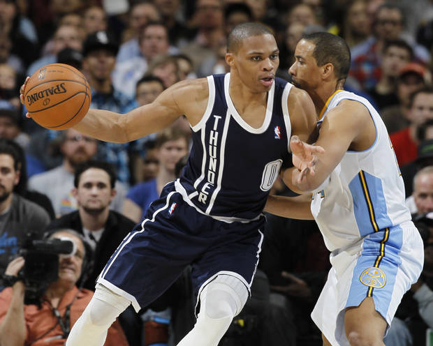 Oklahoma City Thunder guard Russell Westbrook, left, works ball inside for a shot against Denver Nuggets guard Andre Miller in the fourth quarter of the Nuggets' 105-103 victory in an NBA basketball game in Denver on Friday, March 1, 2013. (AP Photo/David Zalubowski) ORG XMIT: CODZ117