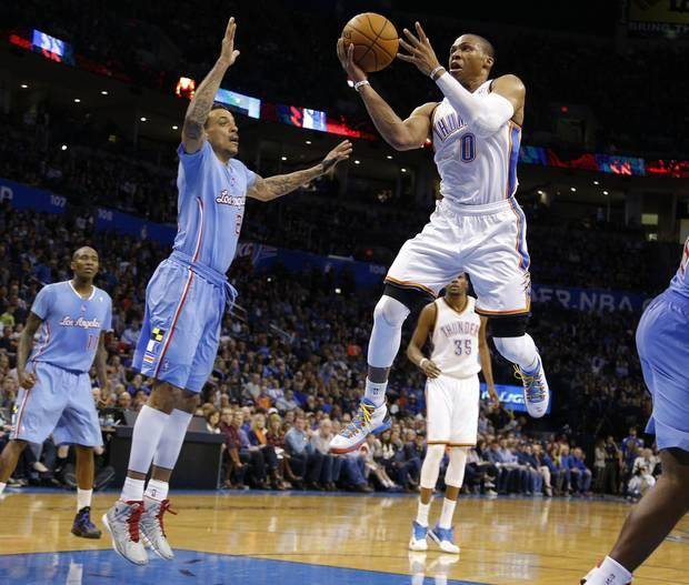 Oklahoma City 's Russell Westbrook (0) drives to the basket as Los Angeles' Matt Barnes (22) defends during the NBA game between the Oklahoma City Thunder and the Los Angeles Clippers at the Chesapeake Energy Arena, Sunday, Feb. 23, 2014. Photo by Sarah Phipps, The Oklahoman
