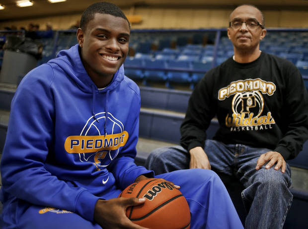 Piedmont High School's Cameron Peters and his father, James, pose for a photo together at the Kingfisher High School gym on Thursday, Jan. 24, 2013, in Kingfisher, Okla.  Photo by Chris Landsberger, The Oklahoman