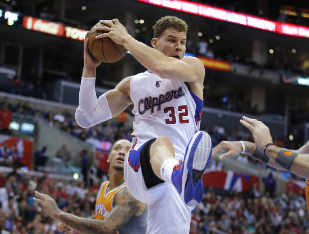 Los Angeles Clippers' Blake Griffin gets a rebound in the first half of an NBA basketball game against the Phoenix Suns in Los Angeles, Saturday, Dec. 8, 2012. (AP Photo/Jae C. Hong)