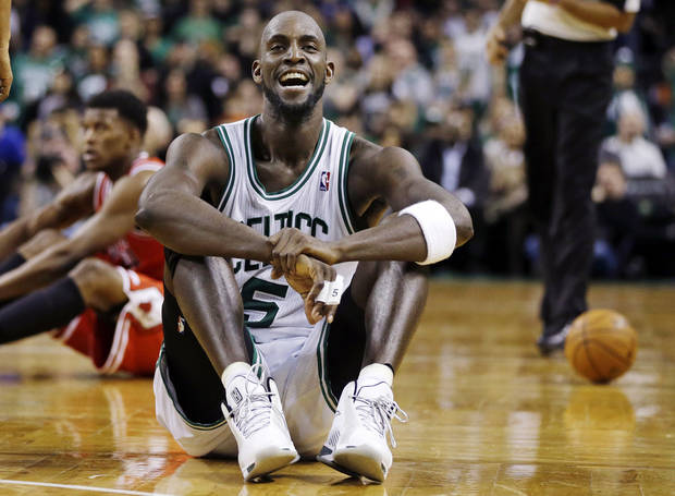 Boston Celtics forward Kevin Garnett (5) reacts on the court after a floor scramble with Chicago Bulls forward Jimmy Butler (21) during the fourth quarter of an NBA basketball game in Boston, Wednesday, Feb. 13, 2013. The Celtics gained possession of the ball and went on to win 71-69. (AP Photo/Elise Amendola) ORG XMIT: MAEA111