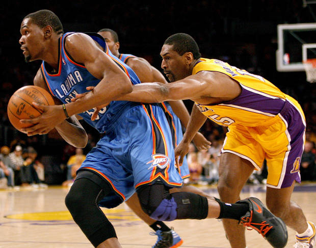 Los Angeles' Metta World Peace (15) defends against Oklahoma City's Kevin Durant (35) during Game 3 in the second round of the NBA basketball playoffs between the L.A. Lakers and the Oklahoma City Thunder at the Staples Center in Los Angeles, Friday, May 18, 2012. Photo by Nate Billings, The Oklahoman