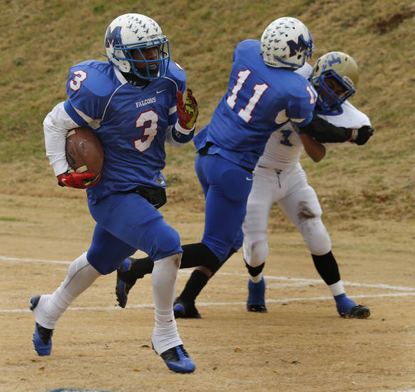 Millwood's Cameron Batson scores in the first half as the Falcons play Hobart in high school football playoffs on Saturday, Nov. 23, 2013, in Oklahoma City, Okla. D'andre Mays blocks Chris Rangel in the background.  Photo by Steve Sisney, The Oklahoman