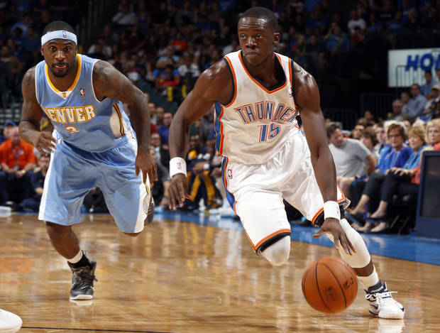 EXHIBITION NBA BASKETBALL GAME: Oklahoma City's Reggie Jackson (15) drives to the basket past Denver's Ty Lawson (3) during the NBA preseason basketball game between the Oklahoma City Thunder and the Denver Nuggets at the Chesapeake Energy Arena, Sunday, Oct. 21, 2012. Photo by Sarah Phipps, The Oklahoman