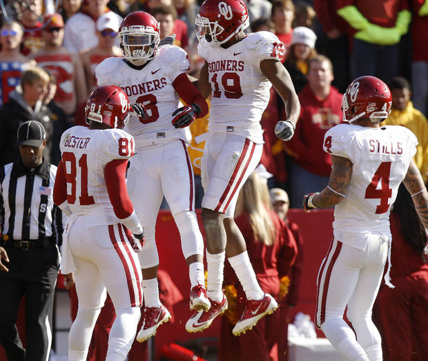 Oklahoma's Sterling Shepard (3) and Oklahoma's Justin Brown (19) celebrate after a touchdown during a college football game between the University of Oklahoma (OU) and Iowa State University (ISU) at Jack Trice Stadium in Ames, Iowa, Saturday, Nov. 3, 2012. Photo by Bryan Terry, The Oklahoman