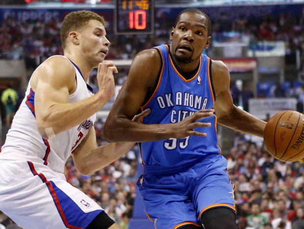 Oklahoma City's Kevin Durant (35) goes around Los Angeles' Blake Griffin (32) during Game 4 of the Western Conference semifinals in the NBA playoffs between the Oklahoma City Thunder and the Los Angeles Clippers at the Staples Center in Los Angeles, Sunday, May 11, 2014. Photo by Nate Billings, The Oklahoman