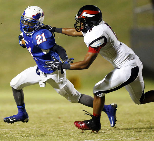 Millwood's Janari Glover (21) tries to avoid Prime Prep's Craig Moore (6) on a carry during a high school football game between Millwood and Prime Prep Academy in Oklahoma City, Friday, Sept. 14, 2012. Photo by Nate Billings, The Oklahoman