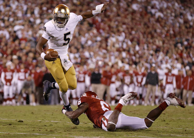 Notre Dame's Everett Golson (5) tries to get past OU's Demontre Hurst (6) during the college football game between the University of Oklahoma Sooners (OU) and the Notre Dame Fighting Irish at Gaylord Family-Oklahoma Memorial Stadium in Norman, Okla., Saturday, Oct. 27, 2012. Oklahoma lost 30-13. Photo by Bryan Terry, The Oklahoman