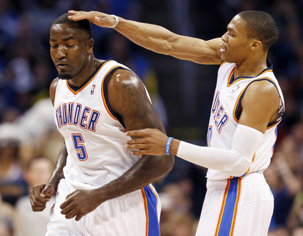 Oklahoma City's Russell Westbrook (0) pats Kendrick Perkins (5) on the head after Perkins made a basket during an NBA basketball game between the Oklahoma City Thunder and Minnesota Timberwolves at Chesapeake Energy Arena in Oklahoma City, Friday, Feb. 22, 2013. Oklahoma City won, 127-111. Photo by Nate Billings, The Oklahoman