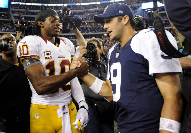 Washington Redskins quarterback Robert Griffin III (10) and Dallas Cowboys quarterback Tony Romo (9) greet each other after their NFL football game, Thursday, Nov. 22, 2012, in Arlington, Texas. The Redskins won 38-31. (AP Photo/Matt Strasen) ORG XMIT: CBS159