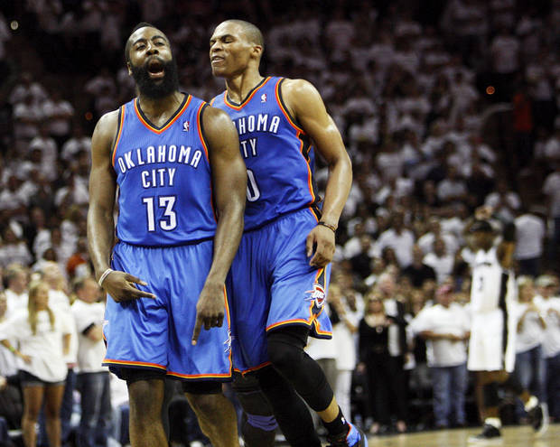 James Harden (13) celebrates with Russell Westbrook (0) after making a 3-point shot late in the fourth quarter during Game 5 of the Western Conference Finals between the Oklahoma City Thunder and the San Antonio Spurs in the NBA basketball playoffs at the AT&amp;T Center in San Antonio, Monday, June 4, 2012. The Thunder won, 108-103. Photo by Nate Billings, The Oklahoman