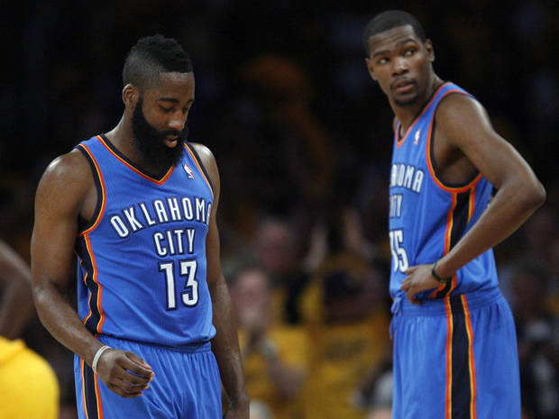 Oklahoma City's James Harden (13) and Kevin Durant (35) react during Game 3 in the second round of the NBA basketball playoffs between the L.A. Lakers and the Oklahoma City Thunder at the Staples Center in Los Angeles, Friday, May 18, 2012. Photo by Nate Billings, The Oklahoman