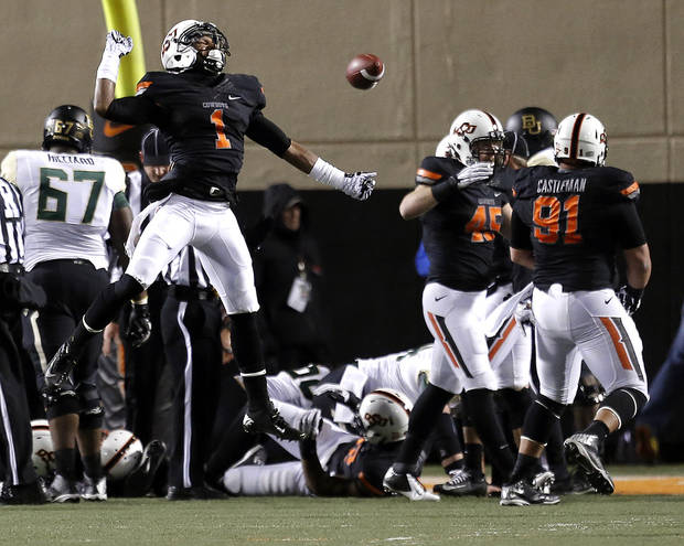 Oklahoma State's Kevin Peterson (1) celebrates a defense stop during a college football game between the Oklahoma State University Cowboys (OSU) and the Baylor University Bears (BU) at Boone Pickens Stadium in Stillwater, Okla., Saturday, Nov. 23, 2013. Photo by Sarah Phipps, The Oklahoman