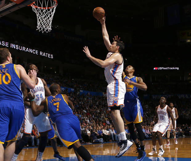 Oklahoma City&#039;s Nick Collison (4) puts up a shot beside Golden State&#039;s Kent Bazemore (20) during an NBA basketball game between the Oklahoma City Thunder and the Golden State Warriors at Chesapeake Energy Arena in Oklahoma City, Wednesday, Feb. 6, 2013. Photo by Bryan Terry, The Oklahoman