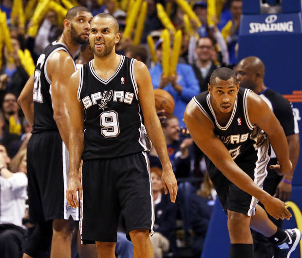 San Antonio's Tony Parker (9) reacts after missing a free throw in front of Tim Duncan (21) and Boris Diaw (33) during an NBA basketball game between the Oklahoma City Thunder and the San Antonio Spurs in Oklahoma City Monday, Dec. 17, 2012. Oklahoma City won, 107-93. Photo by Nate Billings, The Oklahoman