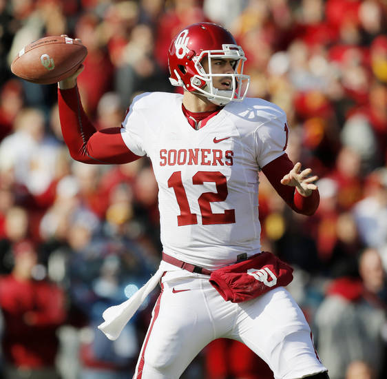 Oklahoma's Landry Jones (12) passes during a college football game between the University of Oklahoma (OU) and Iowa State University (ISU) at Jack Trice Stadium in Ames, Iowa, Saturday, Nov. 3, 2012. Photo by Nate Billings, The Oklahoman