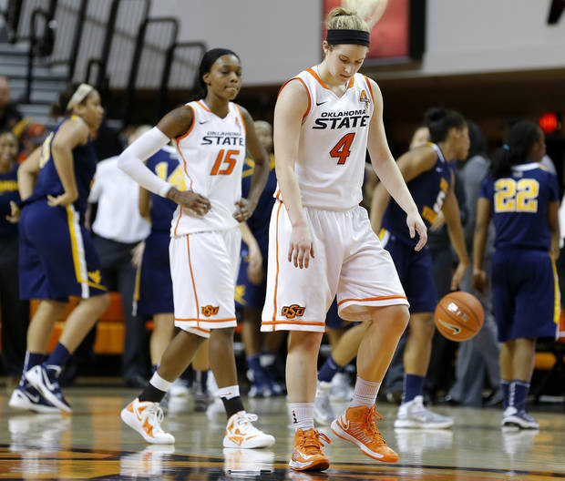 Oklahoma State's Liz Donohoe (4) and Toni Young (15) walk off the court after a women's college basketball game between Oklahoma State and West Virginia at Gallagher-Iba Arena in Stillwater, Okla.,  Tuesday, Jan. 29, 2013. West Virginia won 67-61. Photo by Bryan Terry, The Oklahoman