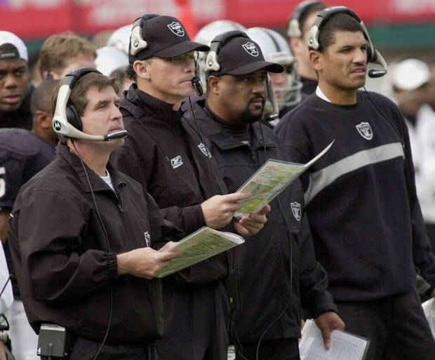Former Oakland Raiders coaches Bill Callahan, left, and offensive coordinator Marc Trestman, second from left, running backs coach Skip Peete, second from right, and tight ends coach Jay Norvell watch their team in 2003. Norvell denies recent allegations that the staff changed the game plan during the Super Bowl against Tampa Bay. AP photo