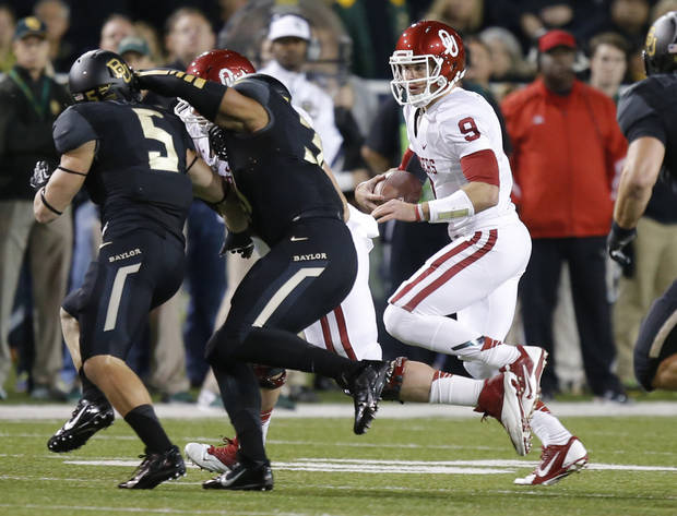 Oklahoma's Trevor Knight (9) runs during an NCAA college football game between the University of Oklahoman (OU) Sooners and the Baylor Bears at Floyd Casey Stadium in Waco, Texas, Thursday, Nov. 7, 2013. Baylor won 41-12. Photo by Bryan Terry, The Oklahoman