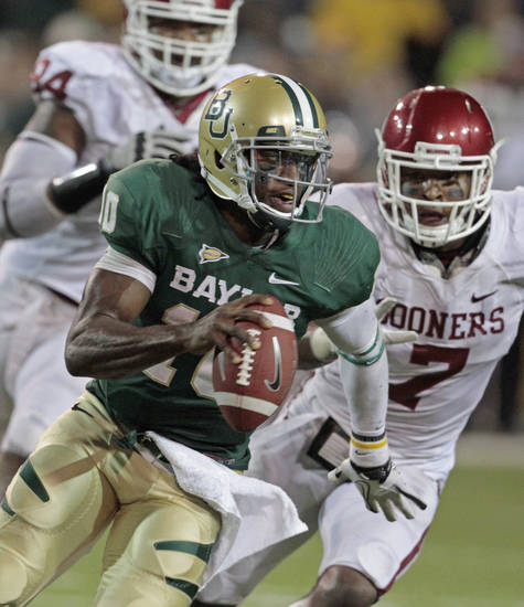 Oklahoma's Frank Alexander (84) and Corey Nelson (7) chase Baylor's Robert Griffin III (10) during the second half of the college football game in which the University of Oklahoma Sooners (OU) was defeated 45-38 by the Baylor Bears (BU) at Floyd Casey Stadium on Saturday, Nov. 19, 2011, in Waco, Texas.   Photo by Steve Sisney, The Oklahoman
