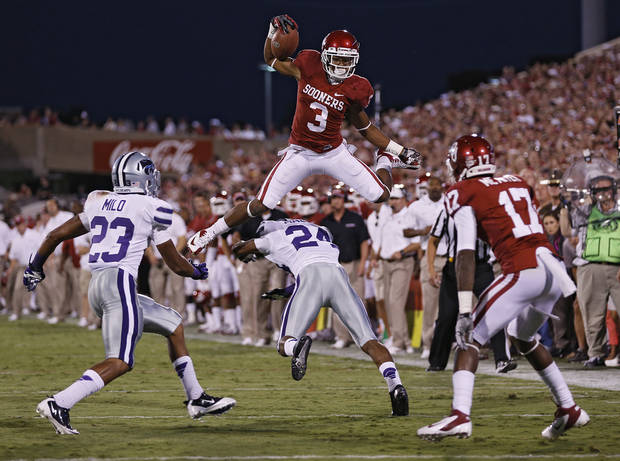 Oklahoma's Sterling Shepard (3) leaps over Kansas State's Nigel Malone (24) during the college football game between the University of Oklahoma Sooners (OU) and the Kansas State University Wildcats (KSU) at the Gaylord Family-Memorial Stadium on Saturday, Sept. 22, 2012, in Norman, Okla. Photo by Chris Landsberger, The Oklahoman