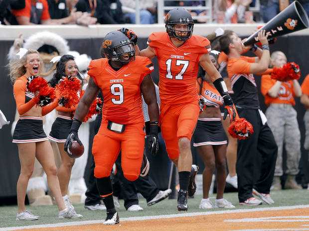 Oklahoma State's Kye Staley (9) and Charlie Moore (17) celebrate a touchdown during a college football game between Oklahoma State University (OSU) and the University of Louisiana-Lafayette (ULL) at Boone Pickens Stadium in Stillwater, Okla., Saturday, Sept. 15, 2012. Photo by Sarah Phipps, The Oklahoman
