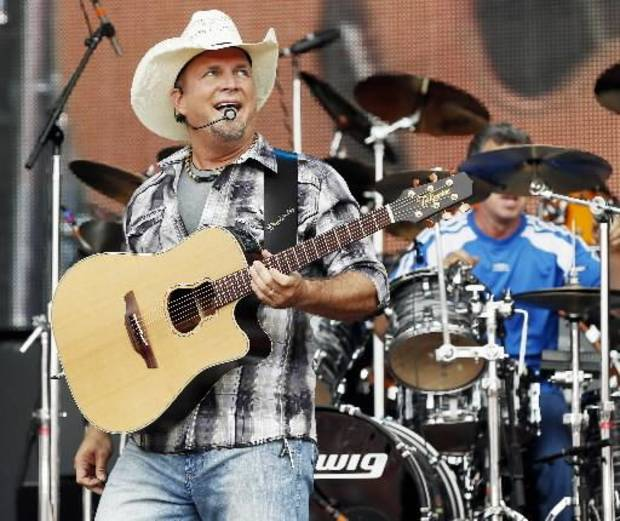 Garth Brooks performs last July at the OK Twister Relief show at the University of Oklahoma. Photo by Nate Billings, The Oklahoman Archive