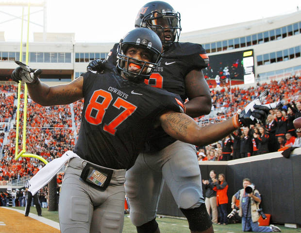 Oklahoma State's Tracy Moore (87) and Kye Staley (9) celebrate a touchdown catch by Moore in the second quarter during a college football game between the Oklahoma State University Cowboys (OSU) and the University of Kansas Jayhawks (KU) at Boone Pickens Stadium in Stillwater, Okla., Saturday, Nov. 9, 2013. Photo by Nate Billings, The Oklahoman