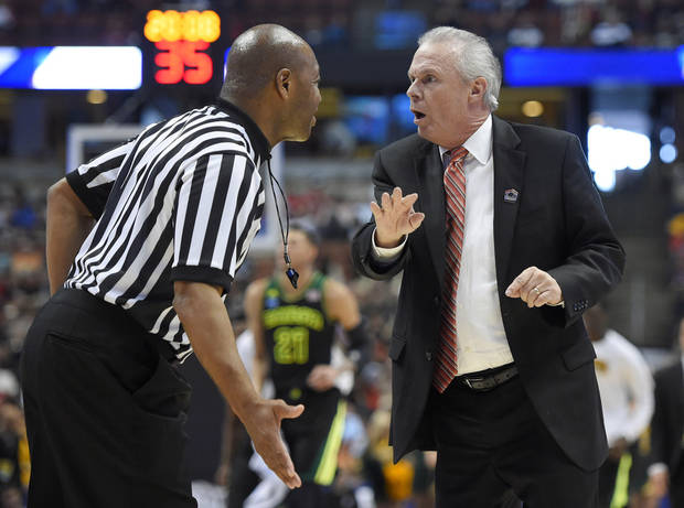 Wisconsin coach Bo Ryan argues a call during the first half against Baylor in an NCAA men's college basketball tournament regional semifinal, Thursday, March 27, 2014, in Anaheim, Calif. (AP Photo/Mark J. Terrill)