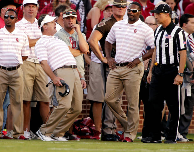 Bob Stoops protest the ejection of Jordan Evans during a college football game between the University of Oklahoma Sooners (OU) and the Louisiana Tech Bulldogs at Gaylord Family-Oklahoma Memorial Stadium in Norman, Okla., on Saturday, Aug. 30, 2014. Photo by Steve Sisney, The Oklahoman