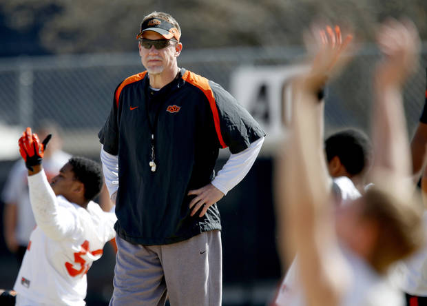 OKLAHOMA STATE UNIVERSITY / OSU / COLLEGE FOOTBALL: Oklahoma State defensive coordinator Glenn Spencer walks the field during an OSU spring football practice in Stillwater, Okla., Wednesday, March 13, 2013. Photo by Bryan Terry, The Oklahoman