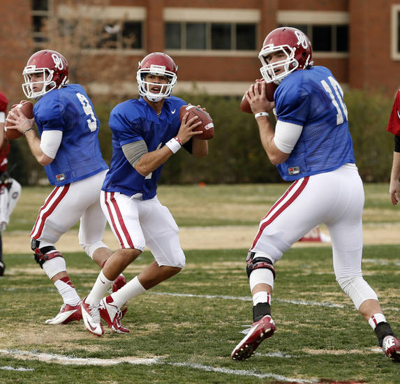 OU quarterbacks, from left, Trevor Knight, Kendal Thompson and Blake Bell are all competing to become the stater when the 2013 season starts. Bell might have an advantage, though, because of his game experience.  Photo by Steve Sisney, The Oklahoman