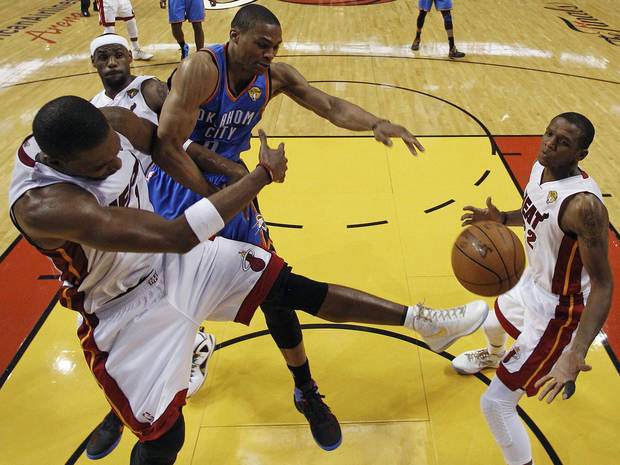 Miami Heat power forward Chris Bosh, left, Oklahoma City Thunder small forward Kevin Durant (35) and small forward LeBron James (6) lose the rebound as Miami Heat small forward James Jones (22) looks on during the first half at Game 3 of the NBA Finals basketball series, Sunday, June 17, 2012, in Miami. (AP Photo/Lynne Sladky, Pool) ORG XMIT: NBA121