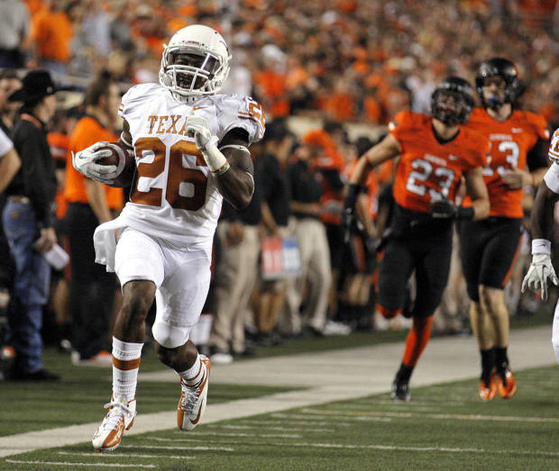 Texas&#039; D.J. Monroe (26) returns a kickoff for touchdown during a college football game between Oklahoma State University (OSU) and the University of Texas (UT) at Boone Pickens Stadium in Stillwater, Okla., Saturday, Sept. 29, 2012. Photo by Sarah Phipps, The Oklahoman