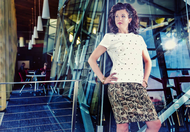 Embellished top with snakeskin print skirt and bracelets, all by Michael Kors from Dillard's, Penn Square Mall. Model is Crystal. Makeup by Andie Vap, hair by T.J. Elias, Trichology Salon. Photo by Chris Landsberger, The Oklahoman. <strong>CHRIS LANDSBERGER</strong>