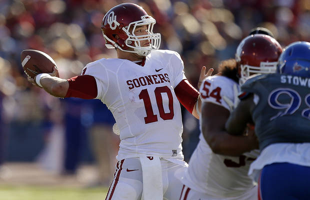 OU's Blake Bell (10) throws a pass during the college football game between the University of Oklahoma Sooners (OU) and the University of Kansas Jayhawks (KU) at Memorial Stadium in Lawrence, Kan., Saturday, Oct. 19, 2013. Oklahoma won 34-19. Photo by Bryan Terry, The Oklahoman