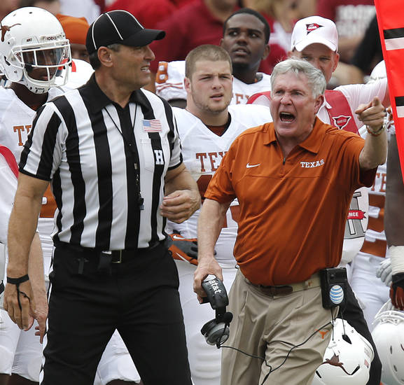 Mack Brown yells at the official during the Red River Rivalry college football game between the University of Oklahoma (OU) and the University of Texas (UT) at the Cotton Bowl in Dallas, Saturday, Oct. 13, 2012. Photo by Chris Landsberger, The Oklahoman