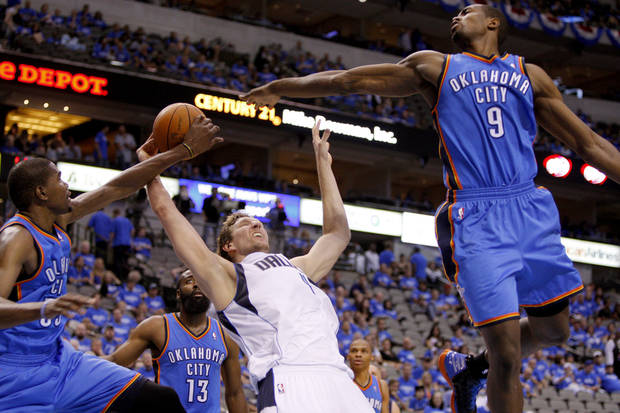 Oklahoma City's Kevin Durant (35) and Serge Ibaka (9) defend Dallas' Dirk Nowitzki (41) during Game 3 of the first round in the NBA playoffs between the Oklahoma City Thunder and the Dallas Mavericks at American Airlines Center in Dallas, Thursday, May 3, 2012. Oklahoma City won 95-79. Photo by Bryan Terry, The Oklahoman