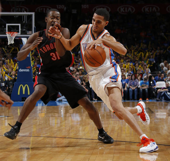 Oklahoma City's Kevin Martin (23) drives past Toronto's Terrence Ross (31) during an NBA basketball game between the Oklahoma City Thunder and the Toronto Raptors at Chesapeake Energy Arena in Oklahoma City, Tuesday, Nov. 6, 2012.  Tuesday, Nov. 6, 2012. Oklahoma City won 108-88. Photo by Bryan Terry, The Oklahoman