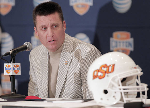 According to Berry Tramel, Oklahoma State has the best track record of hiring assistants as head coaches. (AP Photo/Brandon Wade)