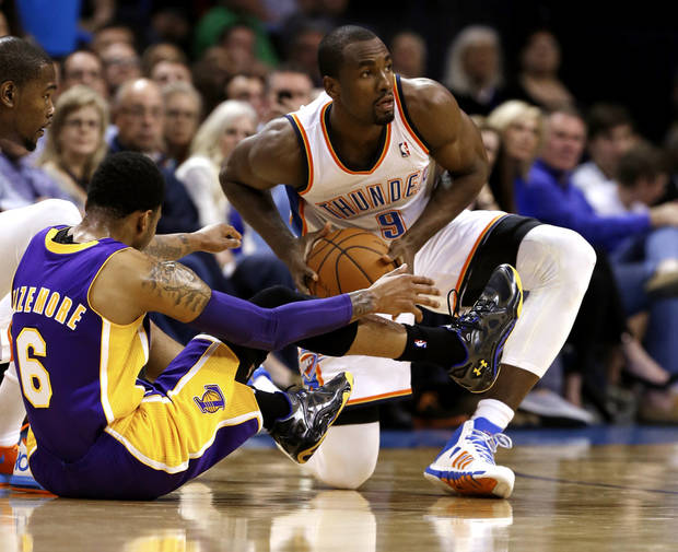 Oklahoma City Thunder's Serge Ibaka (9) gets a loose ball from Los Angeles Laker's Kent Bazemore (6) in the first half of an NBA basketball game where the Oklahoma City Thunder play the Los Angeles Lakers at the Chesapeake Energy Arena in Oklahoma City, on March 13, 2014.  Photo by Steve Sisney The Oklahoman