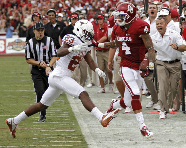 OU&#039;s Kenny Stills (4) is forced out of bounds by UT&#039;s Carrington Byndom (23) during the Red River Rivalry college football game between the University of Oklahoma (OU) and the University of Texas (UT) at the Cotton Bowl in Dallas, Saturday, Oct. 13, 2012. Photo by Chris Landsberger, The Oklahoman