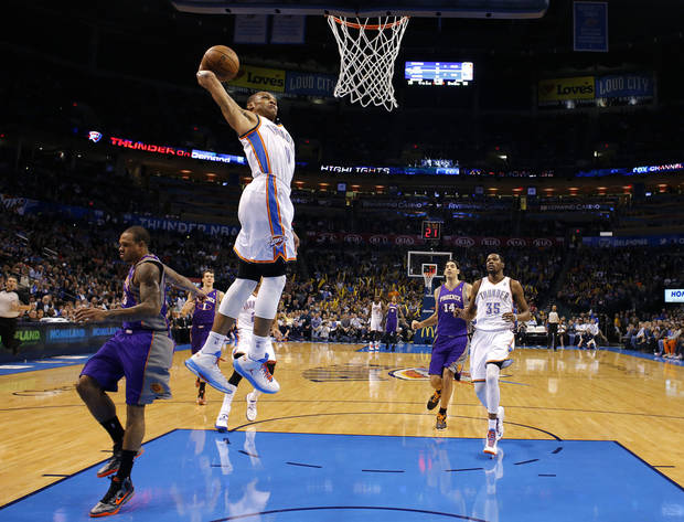 Oklahoma City's' Russell Westbrook (0) dunks in front of Phoenix's Shannon Brown (26) during the NBA game between the Oklahoma City Thunder and the Phoenix Suns at theChesapeake Energy Arena, Friday, Feb. 8, 2013.Photo by Sarah Phipps, The Oklahoman