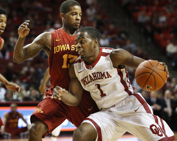 Oklahoma's Sam Grooms (1) drives past Iowa State Cyclone's Korie Lucious (13) as the University of Oklahoma Sooners (OU) men play the Iowa State Cyclones in NCAA, college basketball at Lloyd Noble Center on Saturday, March 2, 2013  in Norman, Okla. Photo by Steve Sisney, The Oklahoman