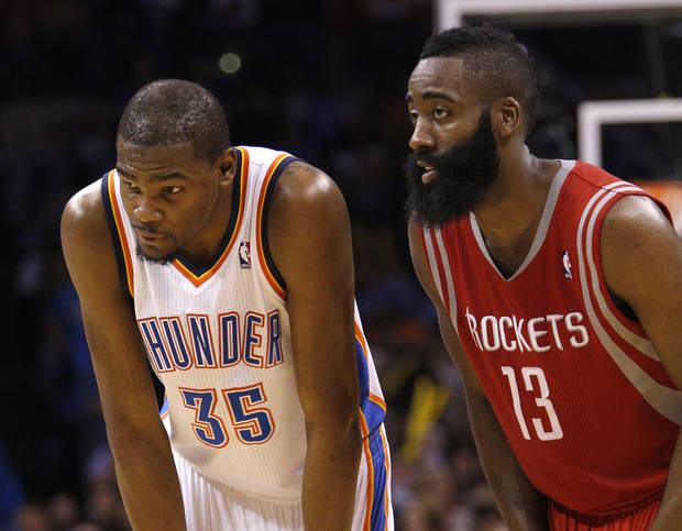 Oklahoma City's Kevin Durant (35) and Houston's James Harden (13) talks during a free throw during the NBA game between the Oklahoma City Thunder and Houston Rockets at the  Chesapeake Energy Arena  in Oklahoma City, Okla., Tuesday, March 11, 2014. Photo by Sarah Phipps, The Oklahoman