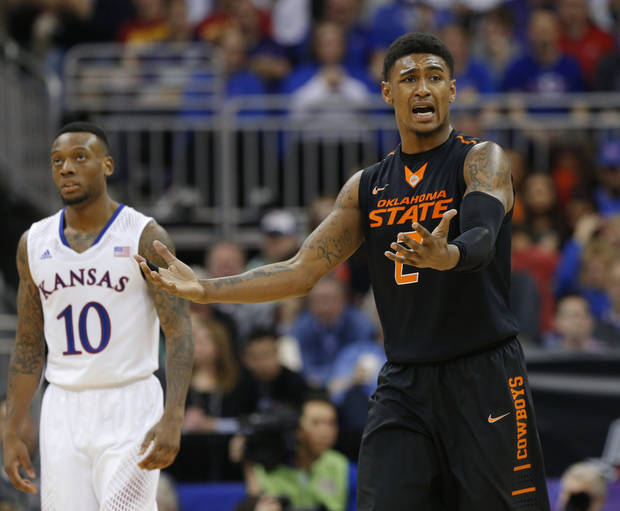 Oklahoma State's Le'Bryan Nash (2) reacts after a play beside Kansas' Naadir Tharpe (10) during the Big 12 Tournament college basketball game between Oklahoma State University and Kansas at the Sprint Center in Kansas City, Mo., Thursday, March 13, 2014. Kansas won 77-70. Photo by Bryan Terry, The Oklahoman