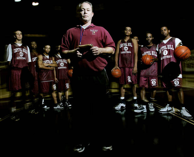 Capitol Hill High School's head basketball coach Donny Tuley poses with his players at The Dome at Capitol Hill High School in Oklahoma City, Okla., Tuesday, Jan. 22, 2007. By John Clanton, The Oklahoman ORG XMIT: KOD